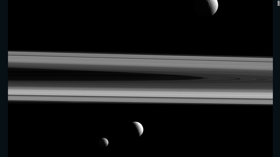 Saturn's moons Tethys, Enceladus and Mimas are shown in this image taken by the Cassini spacecraft on December 3, 2015. Tethys is above the rings, Enceladus is below the rings in the center of the image, and Mimas is below and to the left. Cassini has been exploring Saturn and its moons since 2004. The mission is scheduled to end in September 2017.