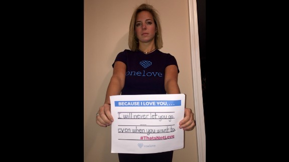 """Mattis Collier's sign says, """"I will never let you go even when you want to. #ThatsNotLove"""""""