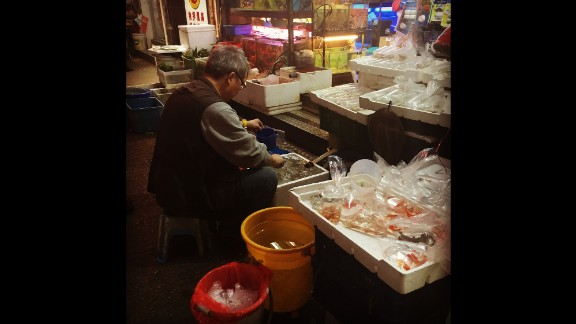 "HONG KONG: ""Goldfish seller bagging his wares in preparation for the evening rush hour. Goldfish have been around for about 1500 years and are considered to have been domesticated in the Song Dynasty around 1000 years ago. They are said to bring luck and so are very popular among Chinese people, who place great value on being lucky (who doesn't)."" - CNN's Brad Olson @cnnbrad."