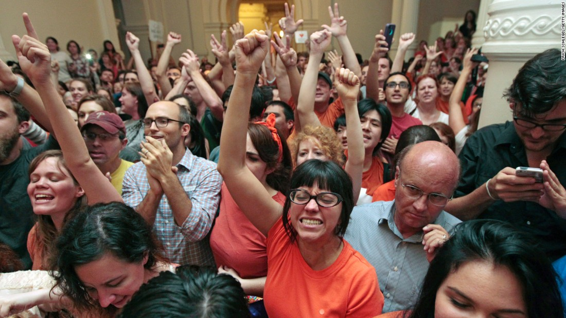 Abortion-rights advocates celebrate the defeat of the measure on June 25, 2013, the last day of that summer's first special legislative session. Davis' filibuster, combined with protests by supporters, helped defeat the legislation at midnight.