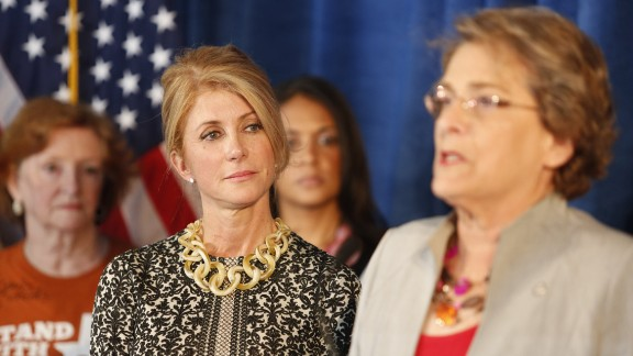 Meanwhile, Wendy Davis' 2013 filibuster propelled her to the Democratic Party's nomination for Texas governor. Here, she listens as Houston City Council member Ellen Cohen speaks about the law in October 2014, just weeks before Davis was defeated by Republican Greg Abbott.