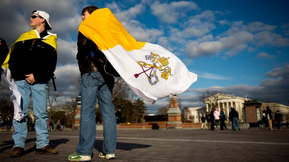 """On the 42nd anniversary of Roe v. Wade -- January 22, 2015 -- Evan Keimig of Houston, left, and Brandan Solcher of Sugarland, Texas, wear Vatican flags in front of the U.S. Capitol following a """"March for Life"""" protest."""