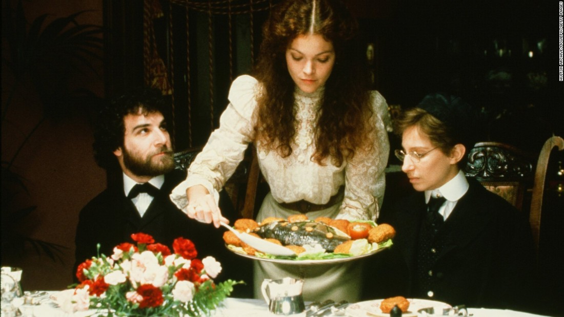 <strong>'Yentl': </strong>Barbra Streisand, right, is shown in this 1984 film playing a Jewish woman who disguises herself as a man to be allowed to learn the Talmud -- the traditional book of Jewish law. Streisand not only took on the lead role, but she also co-produced and directed the film -- becoming the first woman to win a Golden Globe for directing.