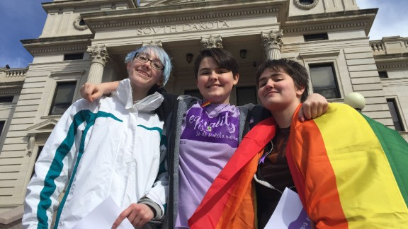 From left to right, transgender students Scout Brown, Nathan Leonard and Thomas Lewis.