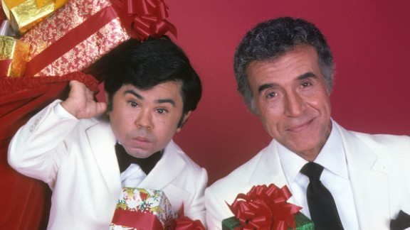 """<strong>'Fantasy Island':</strong> Every week, ABC's """"Fantasy Island"""" began the same way:  Tattoo, played by Herve Villechaize, left, would shout: """"The plane! The plane!"""" Then, Mr. Roarke -- the mysterious island host played by Ricardo Montalban, right -- would remind his employees to welcome the guests with, """"Smiles, everyone, smiles!"""" In a decade of excess, somehow it didn't seem far-fetched to believe in a place where wealthy people would pay huge amounts of money to play out their outlandish narcissistic fantasies."""