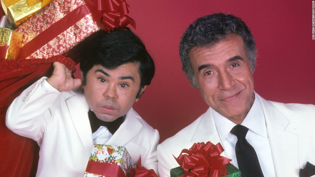 "<strong>'Fantasy Island':</strong> Every week, ABC's ""Fantasy Island"" began the same way:  Tattoo, played by Herve Villechaize, left, would shout: ""The plane! The plane!"" Then, Mr. Roarke -- the mysterious island host played by Ricardo Montalban, right -- would remind his employees to welcome the guests with, ""Smiles, everyone, smiles!"" In a decade of excess, somehow it didn't seem far-fetched to believe in a place where wealthy people would pay huge amounts of money to play out their outlandish narcissistic fantasies."