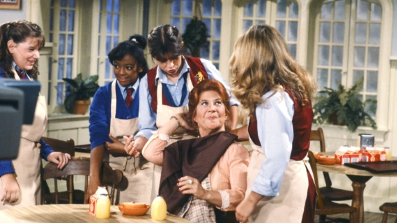 """<strong>'The Facts of Life':</strong> This sitcom was a """"Diff'rent Strokes"""" spinoff, taking its housekeeper character (played by Charlotte Rae, center) and making her the housemother at a school for girls. Who could forget the girls? From left are Mindy Cohn, who played Natalie Green; Kim Fields, who played Dorothy """"Tootie"""" Ramsey;  Nancy McKeon, who played Joanna """"Jo"""" Polniaczek; and Lisa Welchel, who played Blair Warner. Little-known fact: There were four extra girls in the first season of the show, including a then-unknown Molly Ringwald."""