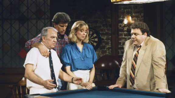 """<strong>'Cheers': </strong>From 1982 to 1993, this sitcom -- set in a Boston bar -- offered viewers a community they could call their own. From left, Nicholas Colasanto played """"Coach,"""" Ted Danson played ex-baseball player Sam Malone, Shelley Long played Malone's romantic interest Diane Chambers, and George Wendt played lovable barfly Norm Peterson. Some """"Cheers"""" characters -- like the know-it-all mailman, Cliff Clavin, unforgettably played by John Ratzenberger -- became so embraced by viewers that they entered almost mythical cultural status."""