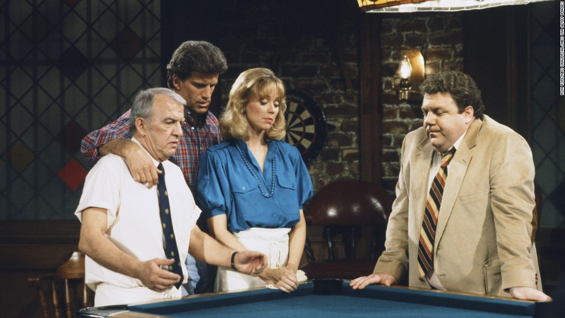 "<strong>'Cheers': </strong>From 1982 to 1993, this sitcom -- set in a Boston bar -- offered viewers a community they could call their own. From left, Nicholas Colasanto played ""Coach,"" Ted Danson played ex-baseball player Sam Malone, Shelley Long played Malone's romantic interest Diane Chambers, and George Wendt played lovable barfly Norm Peterson. Some ""Cheers"" characters -- like the know-it-all mailman, Cliff Clavin, unforgettably played by John Ratzenberger -- became so embraced by viewers that they entered almost mythical cultural status."