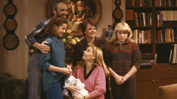 <strong>'Family Ties':</strong> America watched the liberal politics of the '60s and '70s give way to the Reagan '80s right before their eyes on this family sitcom. Young Republican Alex P. Keaton, played by Michael J. Fox, center, made constant fun of his liberal baby boomer parents. No matter what your politics were, it was hard not to laugh when Alex coaches his little brother to say he spent his summer vacation watching the Iran-Contra hearings.