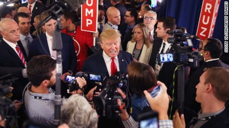 MILWAUKEE, WI - NOVEMBER 10:  Republican presidential candidate Donald Trump speaks with members of the media in the spin room after the Republican Presidential Debate sponsored by Fox Business and the Wall Street Journal at the Milwaukee Theatre on November 10, 2015 in Milwaukee, Wisconsin. The fourth Republican debate is held in two parts, one main debate for the top eight candidates, and another for four other candidates lower in the current polls.  (Photo by Scott Olson/Getty Images)