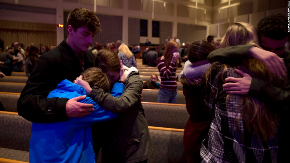 "People pray at a church in Kalamazoo, Michigan, after <a href=""http://www.cnn.com/2016/02/22/us/kalamazoo-michigan-shooting/"" target=""_blank"">several shootings</a> in the area on Sunday, February 21. Police said Jason Brian Dalton gunned down random victims over a nearly five-hour rampage. He has been charged with six counts of murder and two counts of assault with intent to commit murder."