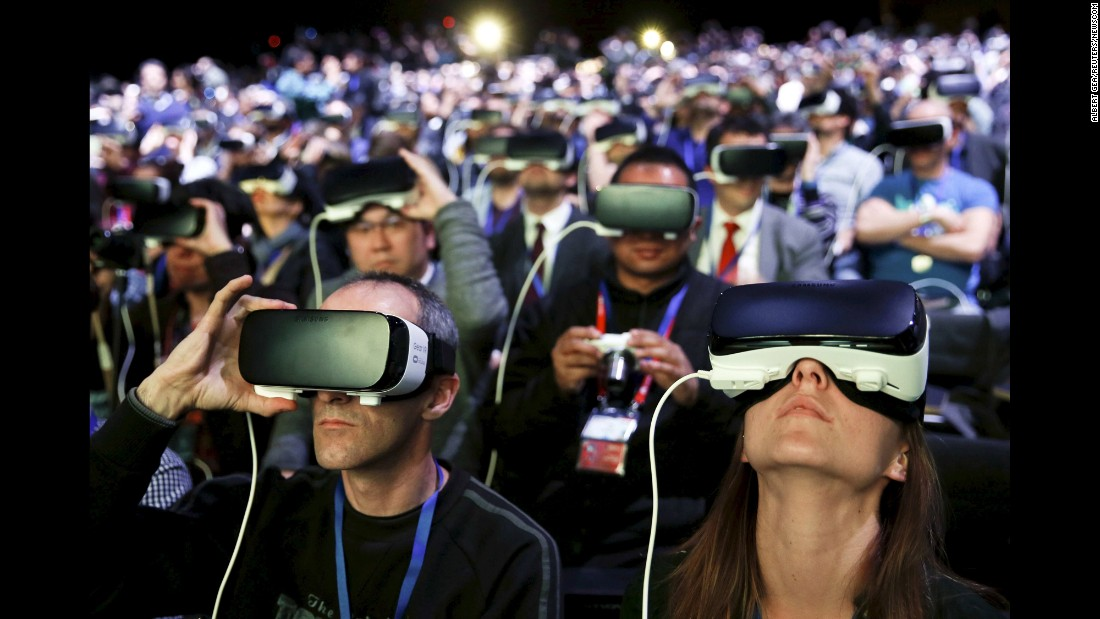People wear virtual-reality devices made by Samsung as they attend the Mobile World Congress in Barcelona, Spain, on Sunday, February 21.