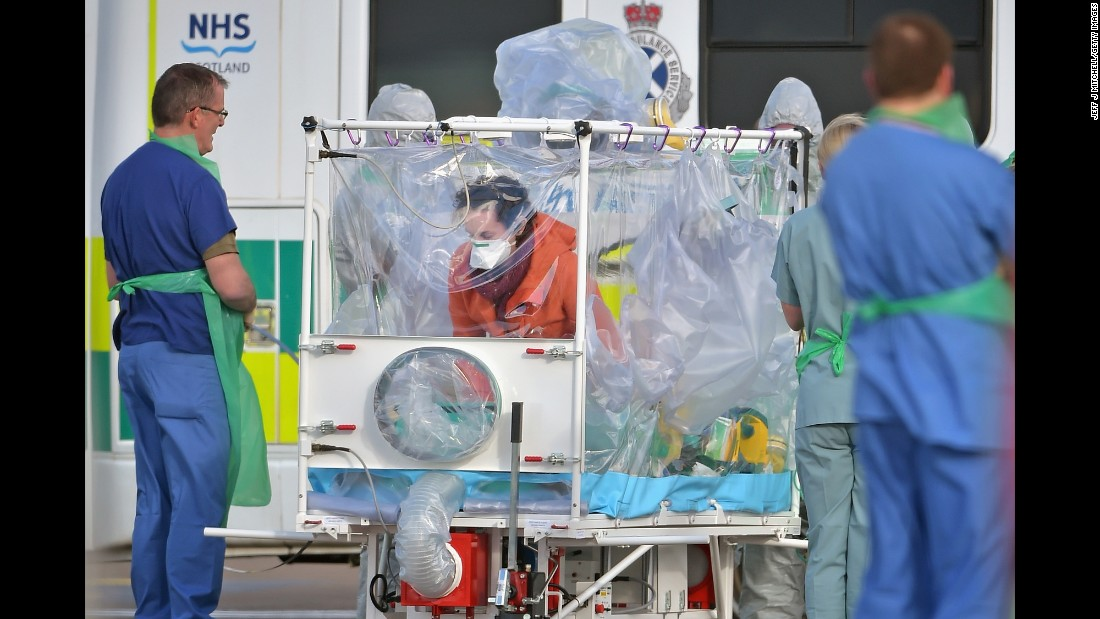 "Pauline Cafferkey enters an isolation tent before boarding a military airplane in Glasgow, Scotland, on Tuesday, February 23. The Scottish nurse <a href=""http://www.cnn.com/2016/02/23/health/uk-ebola-nurse-hospitalized-again/"" target=""_blank"">was transported to a London hospital</a> to be treated for a complication related to Ebola, which she contracted in Sierra Leone 14 months ago."