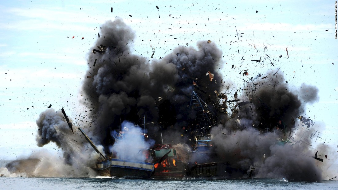 Boats confiscated for illegal fishing are destroyed by Indonesian authorities on Monday, February 22.