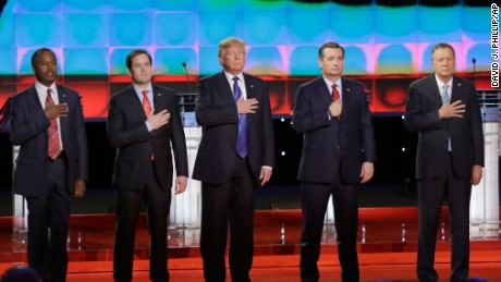 From left, Republican presidential candidates, retired neurosurgeon Ben Carson, Sen. Marco Rubio, R-Fla., businessman Donald Trump, Sen. Ted Cruz, R-Texas, and Ohio Gov. John Kasich listen to the U.S. national anthem before a Republican presidential primary debate at The University of Houston, Thursday, Feb. 25, 2016, in Houston. (AP Photo/David J. Phillip)
