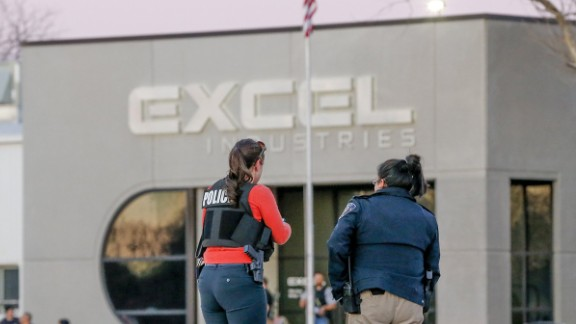 Police guard  Excel Industries. The sheriff told reporters authorities first received a report of a man having been shot while driving. Second, a person was reported shot in the leg. Third, a report came in about a shooting in the parking lot of Excel. Finally, an active shooter was reported inside the workplace.