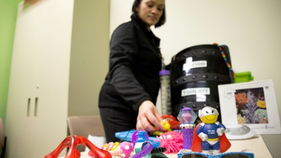 Eileen Walters sorts through some of the toys typically given to soothe children with special needs.