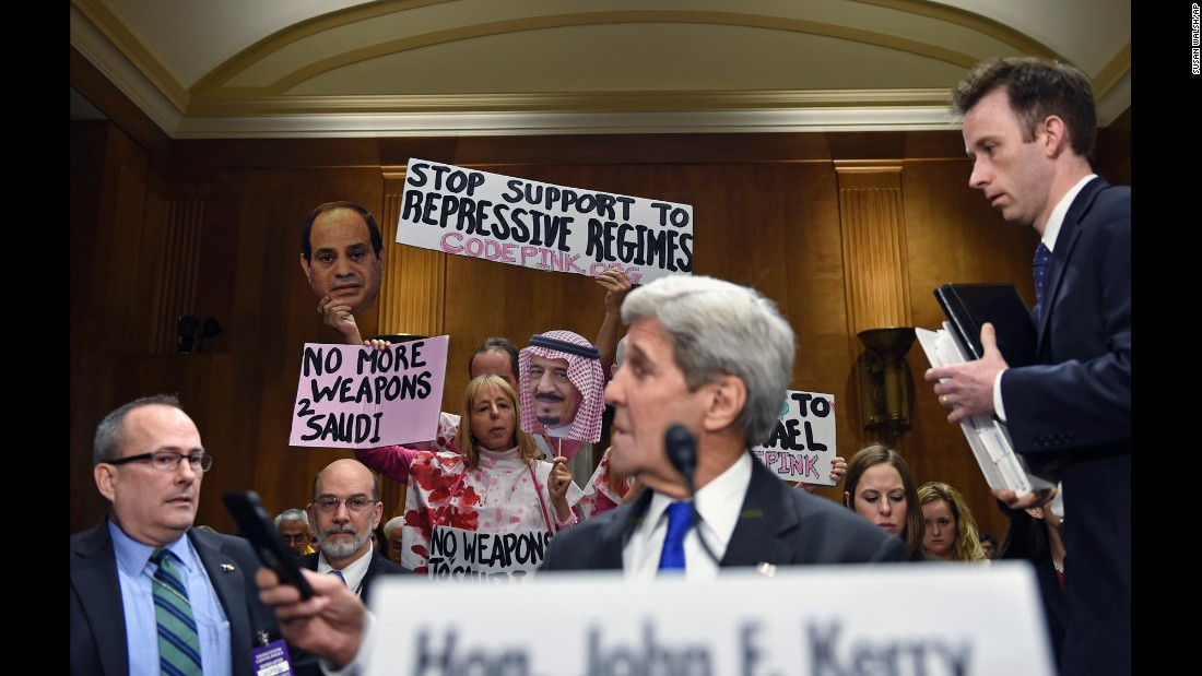 Code Pink co-founder Medea Benjamin, back left, leads demonstrators on Capitol Hill on Tuesday, February 23, as Secretary of State John Kerry prepares to testify before the Senate Foreign Relations Committee hearing on the State Department's fiscal 2017 budget.