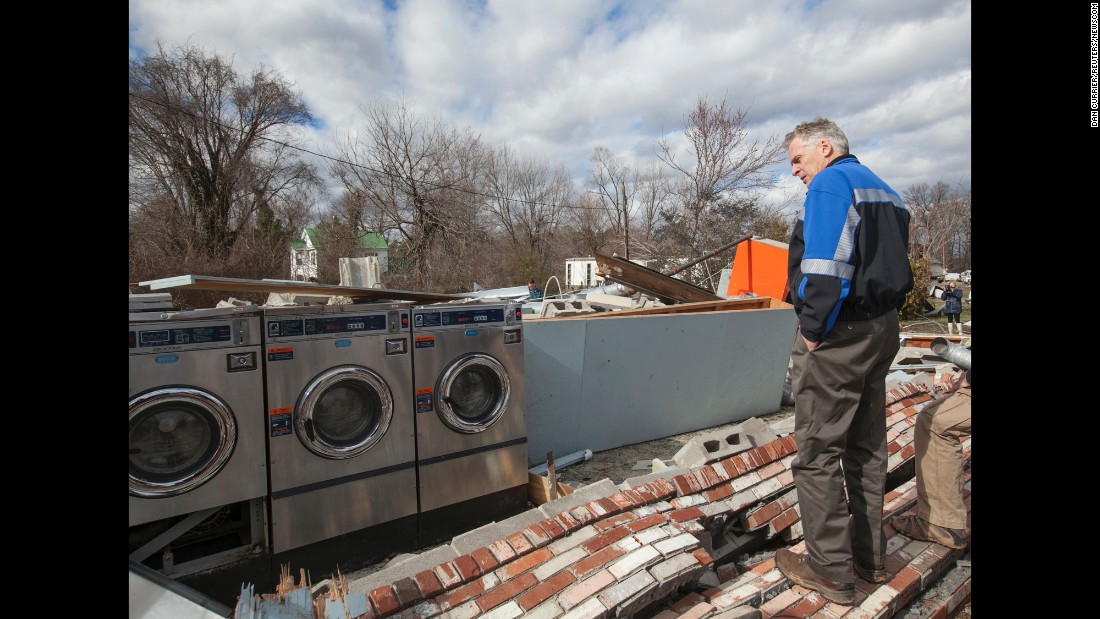 Virginia Gov. Terry McAuliffe surveys tornado damage in Waverly, Virginia, on Thursday, February 25. Residents and rescue crews combed through wreckage left by storms that killed at least eight people and injured scores across several states, officials said. Three died in Waverly.