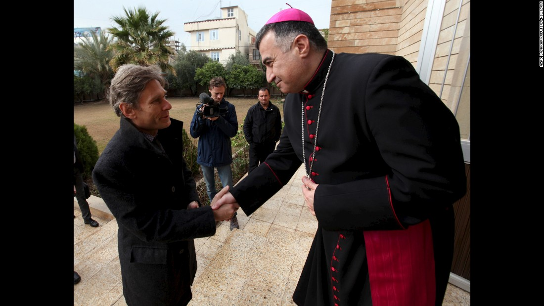 Tom Malinowski, U.S. assistant secretary of state for democracy, human rights and labor, shakes hands with Archbishop Bashar Matti during his visit to the Chaldean Church in Erbil, Iraq, on Tuesday, February 23.