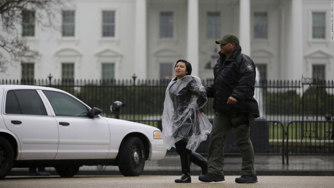 An anti-deportation demonstrator is detained by the police during a protest outside the White House on February 23, 2016.