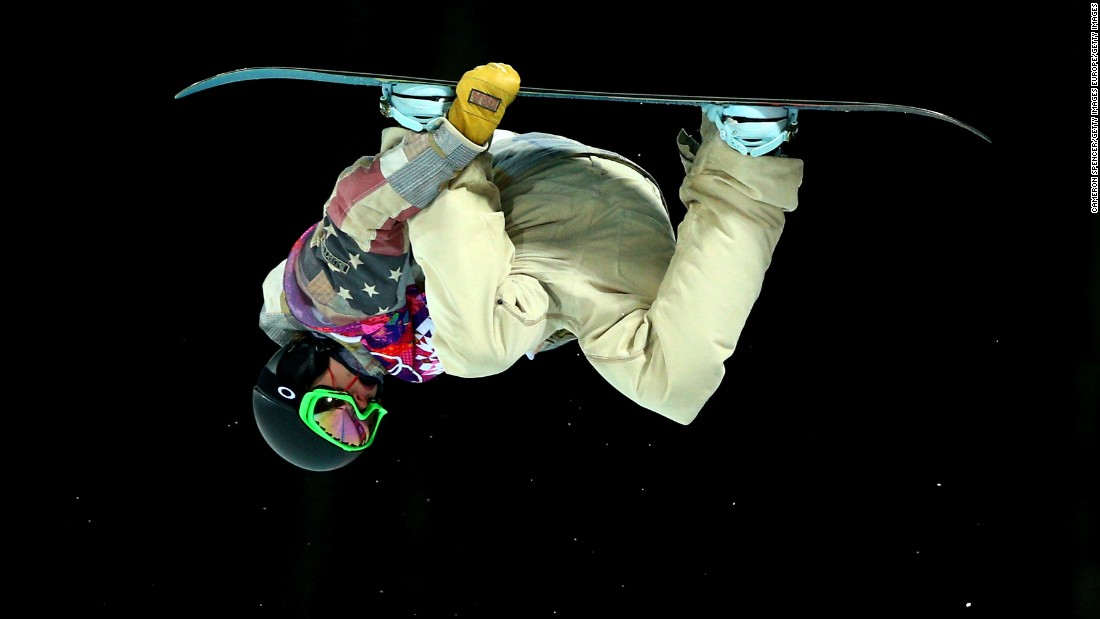 """Most of the time when you're going as big as you can and doing the hardest tricks you can, you're pretty scared,"" admits Taylor Gold -- seen mid-flip in the Snowboard men's halfpipe semifinal at the Sochi 2014 Winter Olympics."