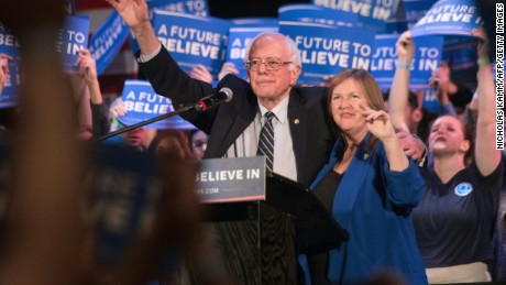 US Democratic presidential candidate Bernie Sanders and his wife Jane wave after he addressed a rally at the Township Auditorium in Columbia, South Carolina, on February 26, 2016.