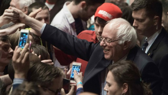 US Democratic presidential candidate Bernie Sanders greets supporters after he addressed a rally at the Township Auditorium in Columbia, South Carolina, on February 26, 2016.