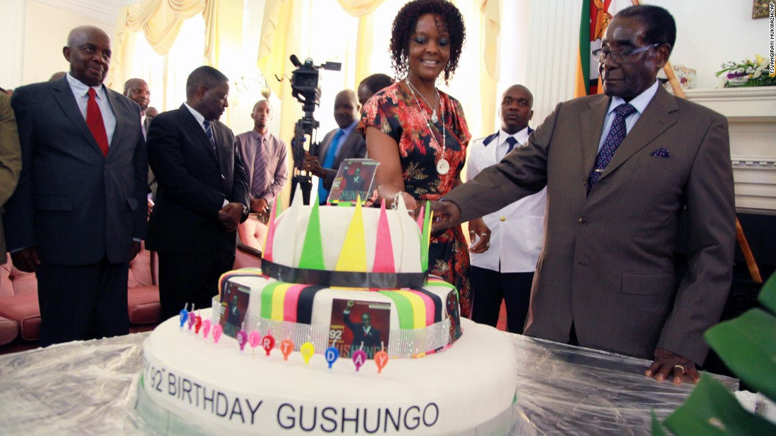 Mugabe and his wife cut a second cake at State House with his  office staff on February 22, 2016.