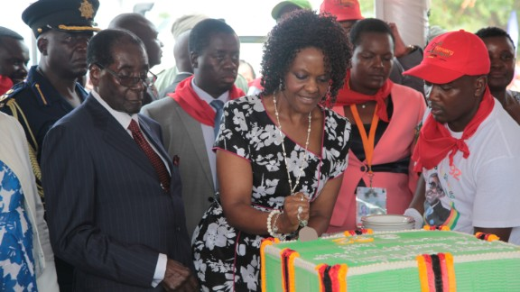 "President Mugabe's wife, Grace, helps him cut a birthday cake at celebrations at Masvingo on Saturday, February 27, 2016. The area is one of the worst drought-stricken regions. The lavish festivities surrounding the president's 92nd birthday have drawn criticism as several regions remain in a ""state of disaster""."