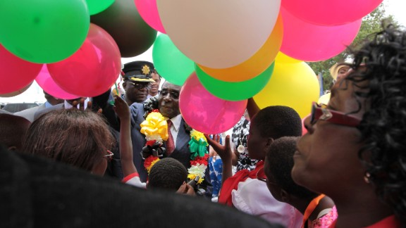 Mugabe is surrounded by a crowd as he prepares to release balloons into the air on February 27, 2016.
