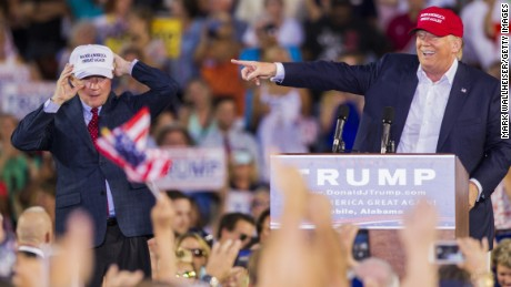 U.S. Republican presidential candidate Donald Trump introduces Alabama Senator Jeff Sessions (R) during his rally at Ladd-Peebles Stadium on August 21, 2015 in Mobile, Alabama.