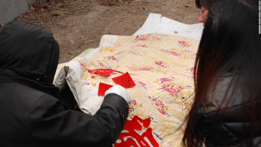 In the winter, charities provide warm clothes and quilts to Beijing's homeless people.