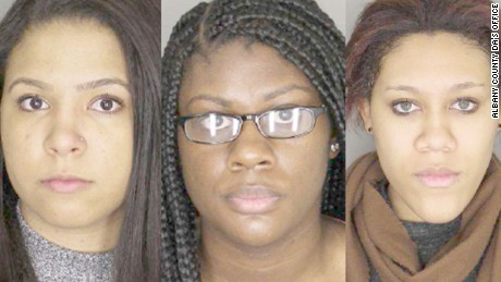 State University of New York students (left to right) Alexis Briggs, Asha Burwell and Ariel Agudio entered not guilty pleas in Albany, New York, Monday, February 29, to charges stemming from what university police say was a false report of a racially motivated attack on a city bus.