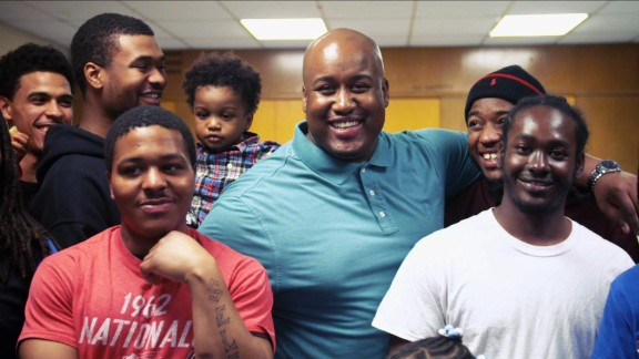 Smith, center, uses the Dovetail Project to help young fathers in Chicago become positive role models.