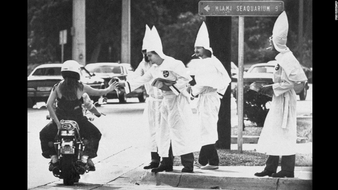 "<strong>Racial tensions ignite:</strong> Ku Klux Klan members hand out propaganda at a busy Miami intersection on January 2, 1982, <a href=""http://www.upi.com/Archives/1983/01/02/About-a-dozen-Ku-Klux-Klan-members-urging-support/9884410331600/"" target=""_blank"">following violent riots</a> sparked by the killing of 20-year-old Nevell Johnson Jr. Johnson, a black man, was shot in the head by white officer Luis Alvarez at a video game arcade in Miami's Overtown neighborhood. Alvarez was later acquitted on manslaughter charges."