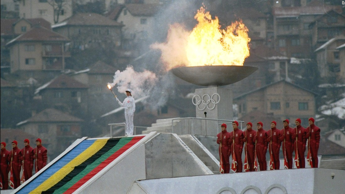 "<strong>Carrying the torch:</strong> Yugoslavian figure skater Sanda Dubravcic lights the <a href=""http://www.olympic.org/Assets/OSC%20Section/pdf/QR_Torches_Relays_WOG_Oslo_%201952_Sochi%202014.pdf"" target=""_blank"">Olympic flame</a> in Sarajevo's Kosevo stadium during the opening ceremonies of the Winter Olympics in 1984."