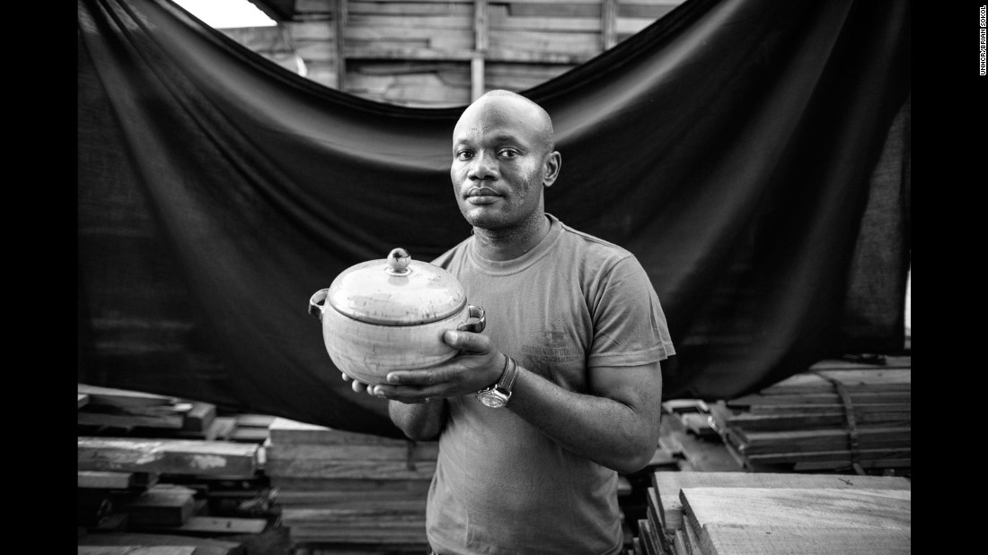 "Edward fled Angola when he was 16, after a rocket exploded 1.2 miles from his family home. They took with them a ""pidi"" jar filled with buffalo meat for the journey ahead, where they encountered the bodies of those less fortunate. Today Edward is an engineer and the jar is the last remnant from that journey to the DRC many years before. ""I can tell my children our family's story through this 'pidi' jar,"" he says. ""Hopefully we will take it when we make the return trip to Angola in the future."""