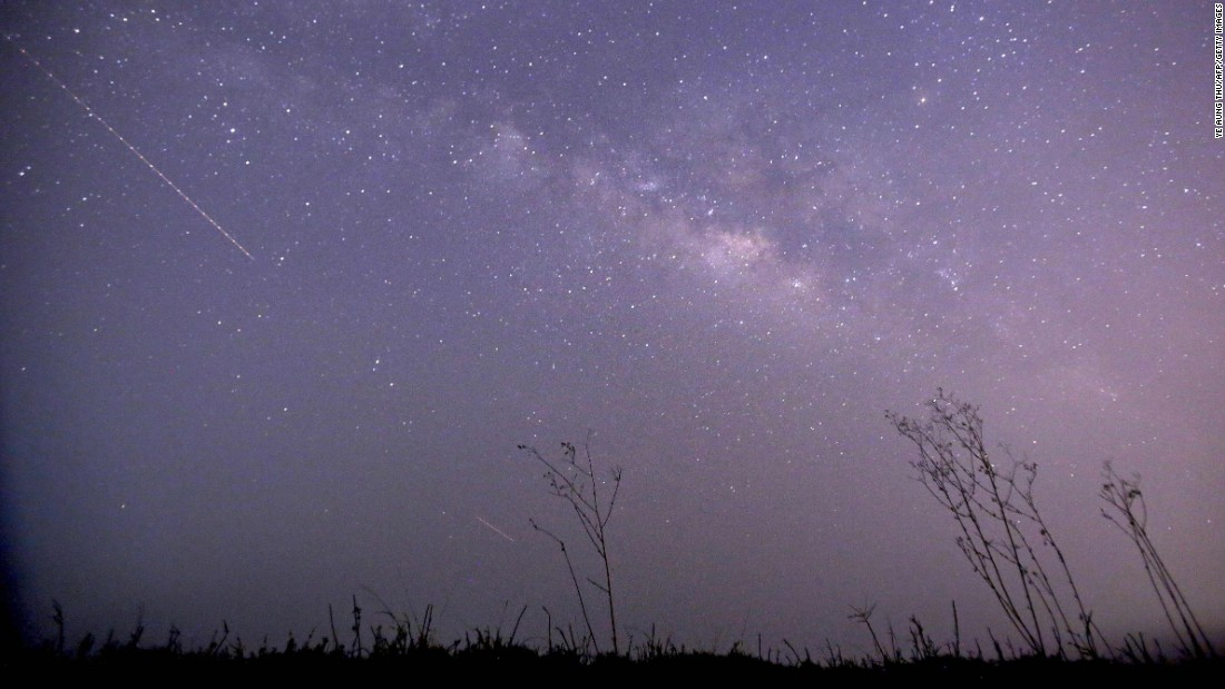 CORRECTION This long-exposure photograph taken on April 23, 2015 on Earth Day shows Lyrids meteors shower passing near the Milky Way in the clear night sky of Thanlyin, nearly 14miles away from Yangon. AFP PHOTO / Ye Aung Thu        (Photo credit should read Ye Aung Thu/AFP/Getty Images)