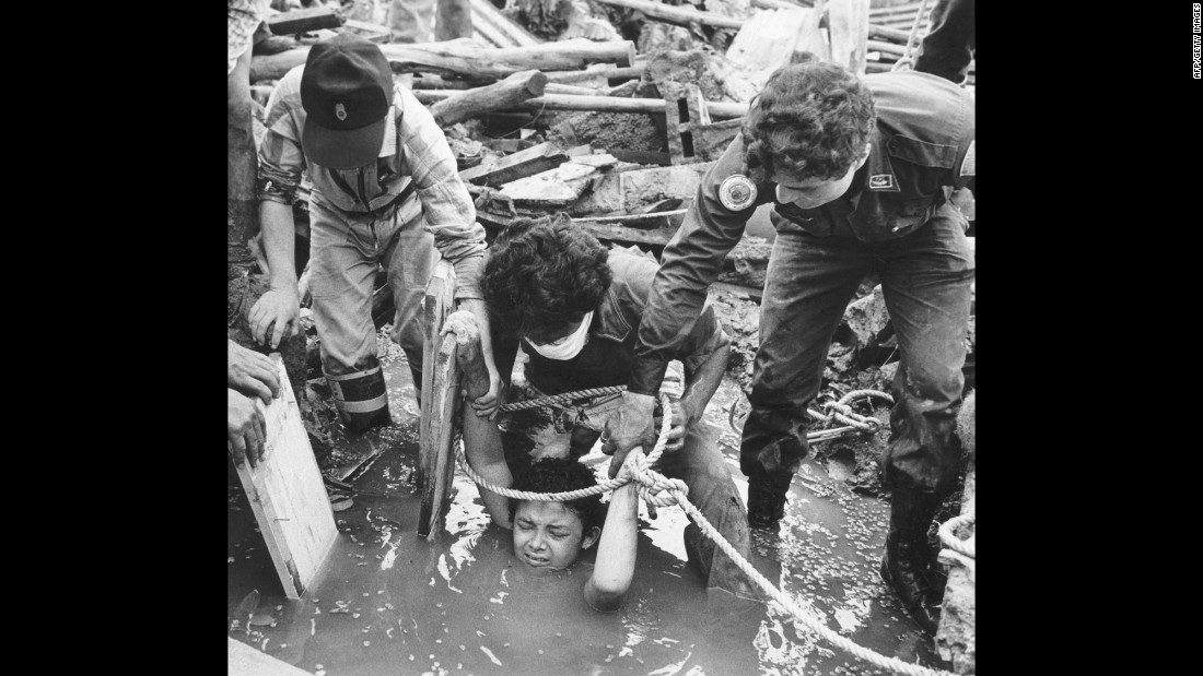 "<strong>Eruption in the Andes:</strong> Rescuers attempt to save 13-year-old Omayra Sanchez, who became trapped by debris after the eruption of Nevado Del Ruiz, a volcano in northern Colombia, on November 13, 1985. The disaster occurred at night, when residents of the nearby town of Armero were sleeping, and <a href=""http://news.bbc.co.uk/onthisday/hi/dates/stories/november/13/newsid_2539000/2539731.stm"" target=""_blank"">about 20,000 people perished</a> as a result. Sanchez eventually died as well after 60 hours stuck in mud and rubble."