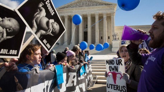WASHINGTON, DC - MARCH 2: Pro-choice advocates (right) and anti-abortion advocates (left) rally outside of the Supreme Court, March 2, 2016 in Washington, DC. On Wednesday morning, the Supreme Court will hear oral arguments in the Whole Woman