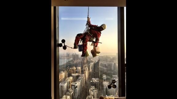 "UNITED ARAB EMIRATES: ""This is not an easy gig. Washing windows by hand in Abu Dhabi. All 90 floors."" - CNN's Jon Jensen @jonjensencnn."