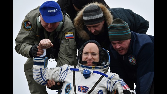 Ground personnel help International Space Station (ISS) crew member Scott Kelly of the U.S. to get off the Soyuz TMA-18M space capsule after landing near the town of Dzhezkazgan, Kazakhstan, Wednesday, March 2, 2016. U.S. astronaut Kelly and Russian cosmonaut Mikhail Kornienko returned to Earth on Wednesday after spending almost a year in space in a ground-breaking experiment foreshadowing a potential manned mission to Mars. (Krill Kudryavtsev/Pool Photo via AP)