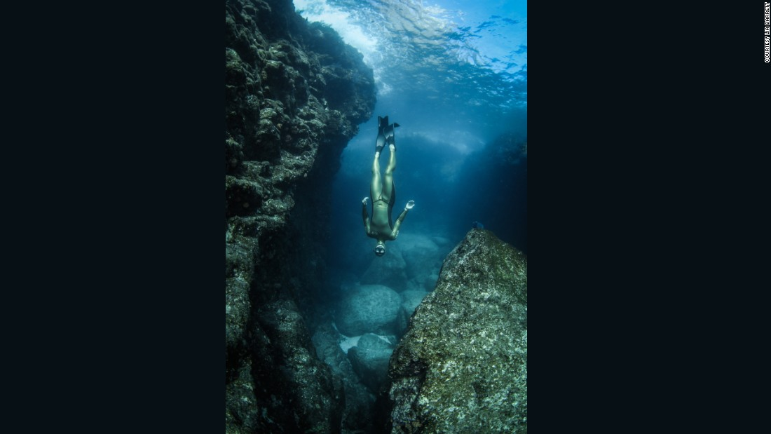 """My friends who freedive while shooting often smirk at the limitations of movement that I have on scuba equipment,"" she added.<br />""I can't simply follow him up and down to the surface, as I risk getting 'the bends.'"""