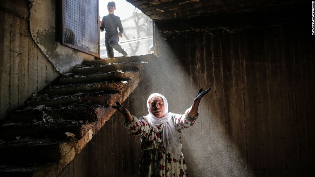 A woman in Cizre, Turkey, walks in the ruins of a damaged building on Wednesday, March 2, following heavy fighting between government troops and Kurdish fighters. Thousands of residents in the Kurdish-majority town began returning to their homes after authorities partially lifted a curfew that was put in place to root out rebels.