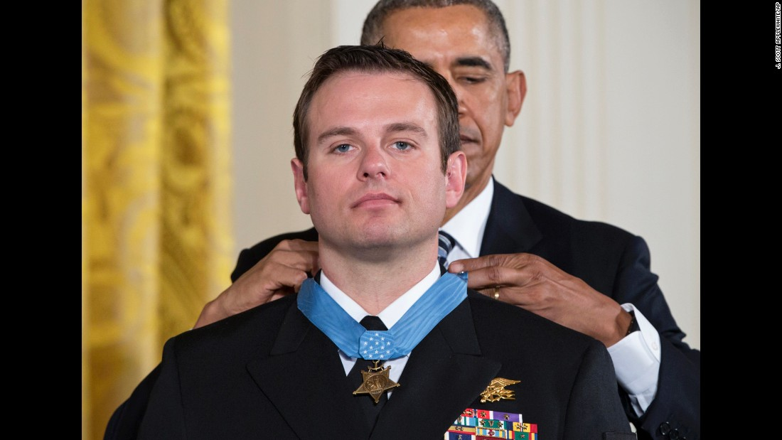 "U.S. President Barack Obama presents Navy SEAL Edward Byers <a href=""http://www.cnn.com/2016/02/29/politics/medal-of-honor-navy-seal-edward-byers/"" target=""_blank"">with the Medal of Honor</a> during a ceremony at the White House on Monday, February 29. Byers received the medal for his role in rescuing an American civilian being held hostage by Taliban insurgents in Afghanistan. <a href=""http://www.cnn.com/2014/05/13/politics/gallery/afghanistan-vets-medal-of-honor/index.html"" target=""_blank"">See other Afghanistan veterans who have received the Medal of Honor</a>"