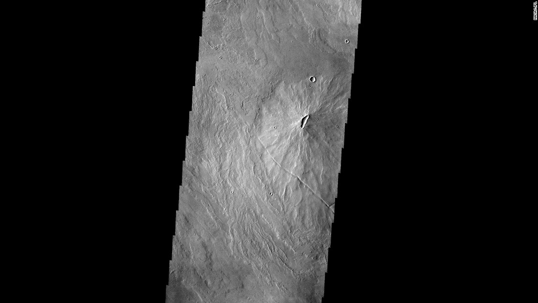 This image taken by the Mars Odyssey spacecraft shows volcanoes dotting the Martian landscape in the Tharsis region.