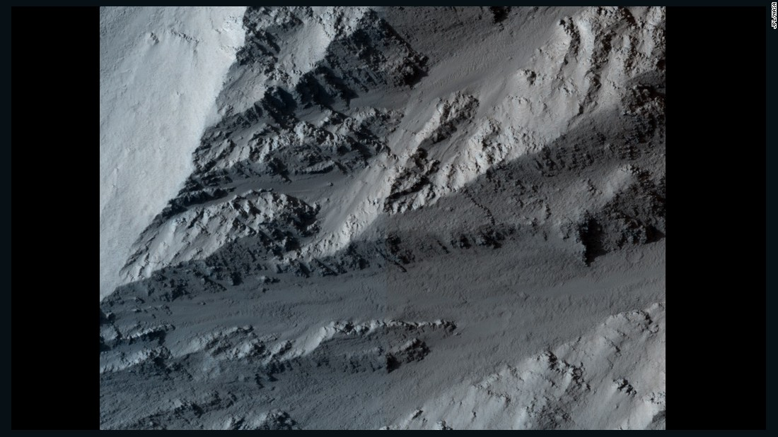 This image shows the northern edge of Olympus Mons on Mars. The cliff has hard layers of lava and soft layers that may be dust or volcanic ash. The image was taken by NASA's Mars Reconnaissance Orbiter on March 2, 2010.