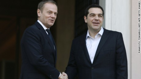 The European Council's Donald Tusk, left, meets Greek Prime Minister Alexis Tsipras.